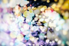 Festive Christmas background. Elegant abstract background with bokeh defocused lights and stars. Christmas Background.Holiday Abstract Glitter Stock Photos