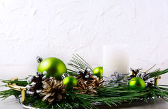 Christmas background with holiday ornaments and candle centerpie Royalty Free Stock Photo