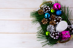 Christmas background with holiday ornaments, candle and pine con Stock Photo