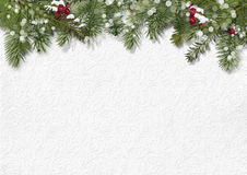 Christmas background with holly, firtree. Christmas background with beautiful décor of fir branches, holly and poinsettia with place for photos or royalty free stock photos
