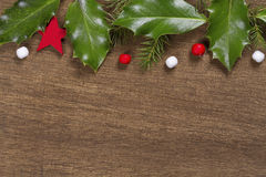 Christmas background with Holly leaves and berries Royalty Free Stock Image