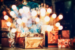 Christmas background , home scene with holiday gifts and festive bokeh Royalty Free Stock Images
