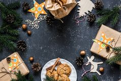 Christmas background with homemade gifts, christmas decorations, cookies and free space, top view. Flat lay stock images