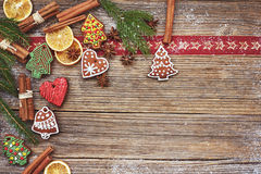 Christmas background. Homemade gingerbread cookies, cinnamon, Christmas tree on old wooden background. Toned, soft focus, copy spa Royalty Free Stock Images