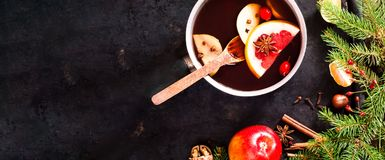 Christmas background. Hot mulled wine with ingredients in authentic ladle on on vintage rusty metal background. royalty free stock photo