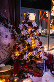 Christmas background with illuminated fir tree and fireplace, clock at house stock photography