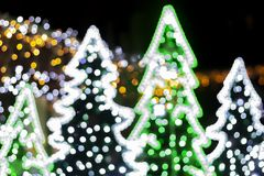 Christmas background, image blur colorful bokeh defocused. Lights decoration on christmas tree royalty free stock images