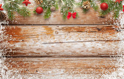 Christmas background image. wooden table with free space for text. Top view of table. Christmas tree and decorations beside Stock Images