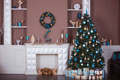 Christmas background. Interior room decorated in xmas style. No people. New year tree and fireplace. Interior room decorated in Christmas style. No people. Home Royalty Free Stock Photos