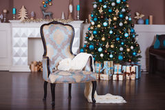 Christmas background. Interior room decorated in xmas style. No people. New year tree and fireplace Royalty Free Stock Photos