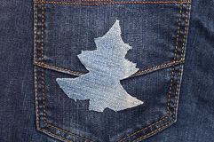 Christmas background. Jeans texture with shape Christmas tree Royalty Free Stock Photo