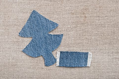 Christmas background. Jeans texture with shape Christmas tree on a canvas background Stock Photo