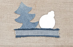 Christmas background. Jeans texture with shape Christmas tree on a canvas background Stock Image