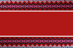Christmas background with knitted border. Red Christmas background with knitted border royalty free stock images