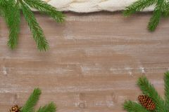 Christmas background of knitting, fir branches, pine cones and o. Christmas background of knitting, fir branches, pine cones and wooden boards Stock Photos
