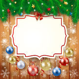 Christmas background with label and baubles Stock Photos