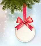 Christmas background with a label and a bow. Stock Photo