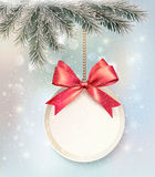 Christmas background with a label and a bow. Royalty Free Stock Photos