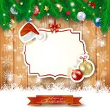 Christmas background with label, hat and baubles Royalty Free Stock Image