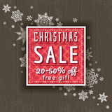 Christmas background and  label with sale offer Royalty Free Stock Images
