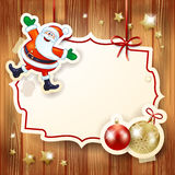 Christmas background with label, Santa and baubles Stock Photos