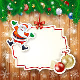 Christmas background with label, Santa and baubles Stock Photography