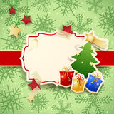 Christmas background with label, tree and gifts Royalty Free Stock Photo
