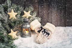 Christmas background with lantern and mittens Royalty Free Stock Photo