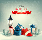 Christmas background with a lantern and presents. Stock Photography
