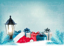 Christmas background with a lantern and presents. Stock Photos