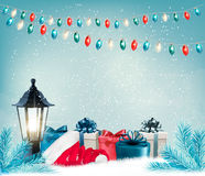 Christmas background with a lantern and presents. Royalty Free Stock Image