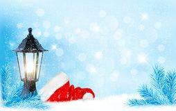 Christmas background with a lantern and a Santa hat. Royalty Free Stock Photo