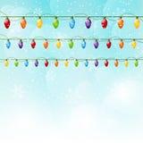 Christmas background with light bulbs. Christmas blue background with light bulbs Royalty Free Stock Photography