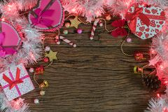 Christmas background, light and gift box. On old wood background, Xmas and New year concept Stock Image