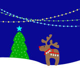 Christmas background with lights. Christmas card with holiday lights, cute beige reindeer wearing red nose, Christmas bells and harness, fir-tree decorated with Royalty Free Stock Photography
