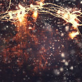 Christmas background with lights garland over wooden background Stock Photography