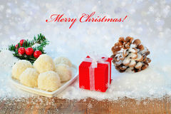 Christmas background with lights gift chocolate and pine cone Stock Images