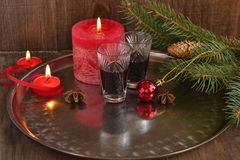Christmas background with liquor, spices, candles and fir branches Stock Photo