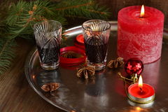 Christmas background with liquor, spices, candles and fir branches Royalty Free Stock Image