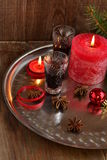 Christmas background with liquor, spices, candles and fir branches Royalty Free Stock Photo
