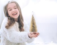 Christmas background with a little girl and a beautiful little C stock photo