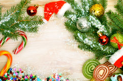 Christmas background, lollipops, pine twig, sweets Royalty Free Stock Photography