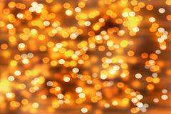 Christmas background with lots of  golden blurry lights.  Stock Image