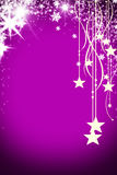 Christmas background with luminous garland with stars, snowflakes and place for text. Purple sparkly holiday background. With copy space. Silver and gold Stock Image