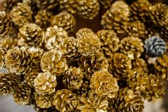 Christmas background of many small golden cones stock photos