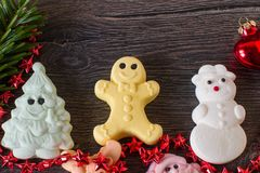 Christmas background with marshmallow tree, ginger man, and snowman candies. Christmas background with fir tree,and marshmallow candies Royalty Free Stock Photos