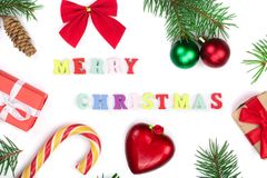Christmas background with merry christmas inscription decorated with fir branches isolated on white background. Flat lay stock photo