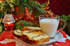 Christmas background milk and sweet bread snack for Santa Stock Photo