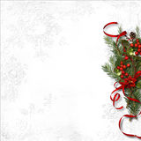 Christmas background with mistletoe and holly on white paper Stock Photo