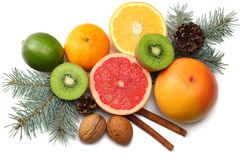 Christmas background. mix sliced lemon, green lime, orange, mandarin, kiwi fruit and grapefruit with cone and fir tree isolated stock images